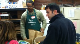 Stephen McDow serving a guest at Open Table.