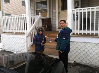 Sebastien talking with Lowell resident about fire prevention.