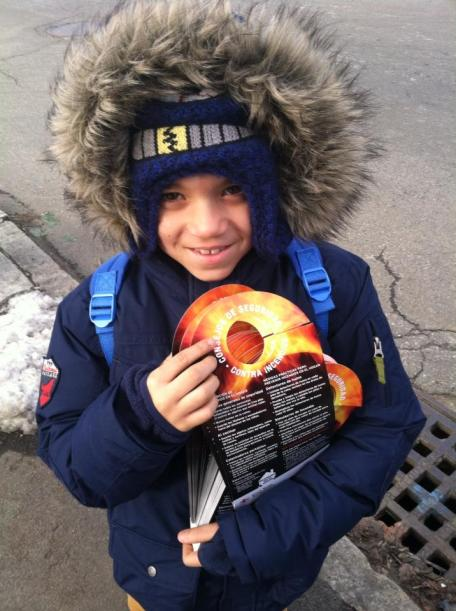 Sebastien holding fire prevention information.