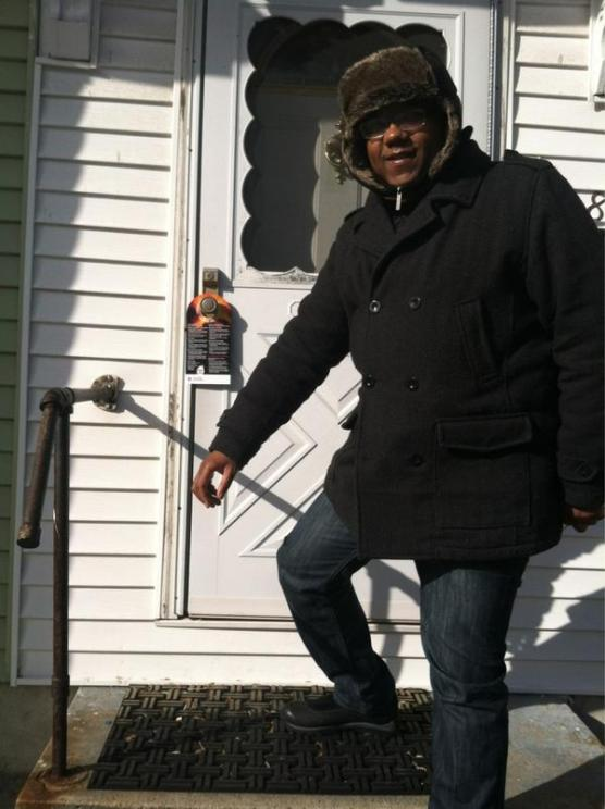 Stephen McDow hanging fire prevention information at a Lowell, MA home.