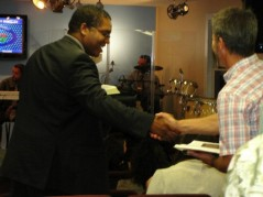 Stephen McDow shaking hands with Martha's Vineyard resident.