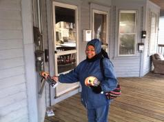 Sylvia hanging Red Cross fire prevention information in Lowell, MA.