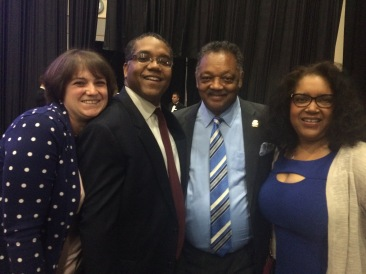 Stephen McDow with the Reverend Jessie Jackson, Rebecca McDow and Wanda Spence.